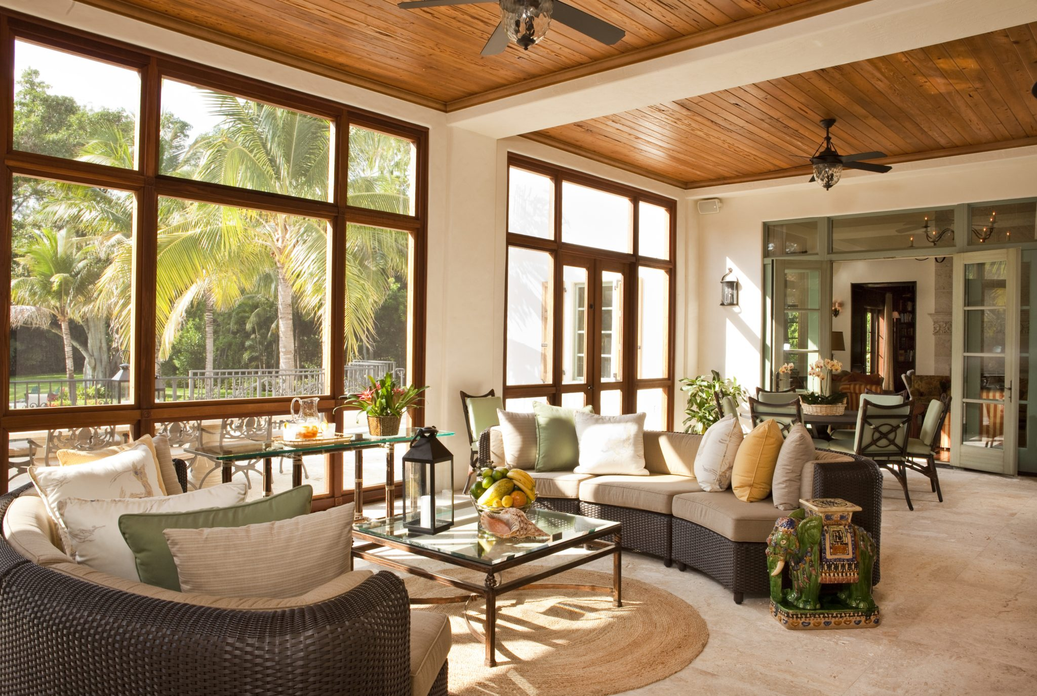 A screened-in, outdoor living room with apecky cypress ceiling that adds an undeniably tropical feel.By Taylor & Taylor