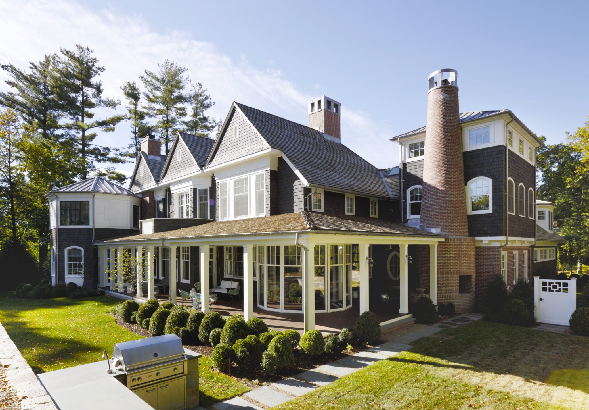 Short Hills Shingle Style Residence, Covered Porch with Fireplace by Douglas C. Wright Architects