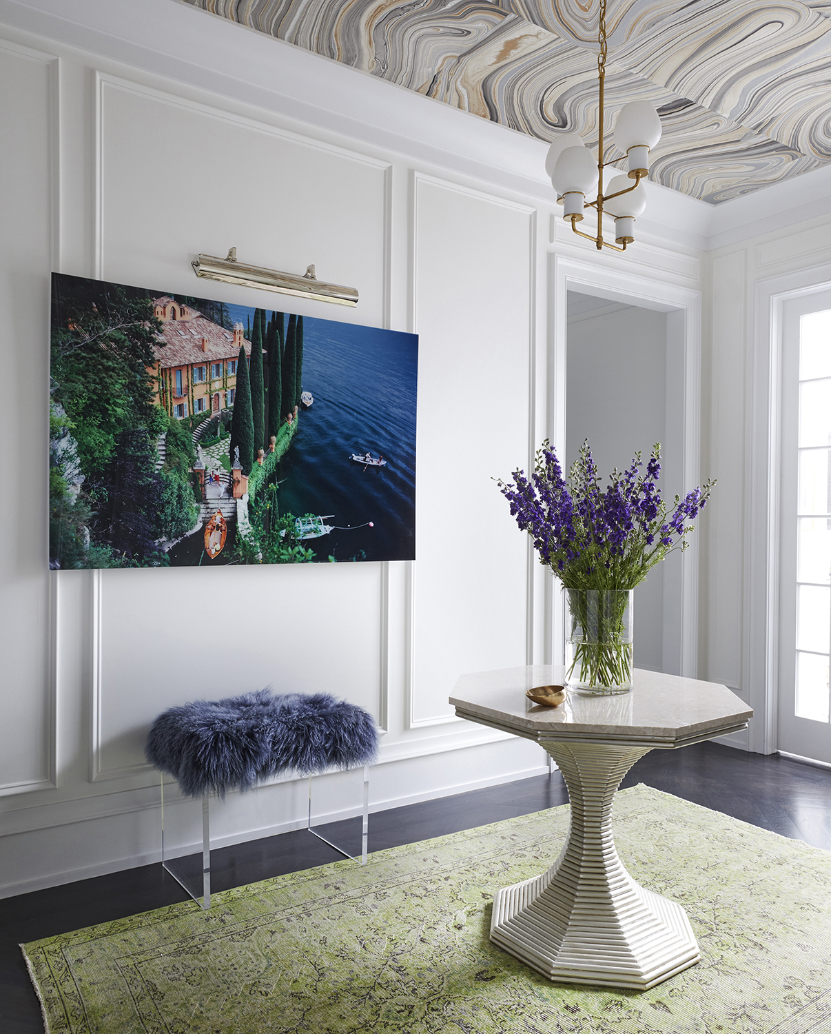 Gallery with custom print ceiling, wainscoting, and tulip pedestal table by Summer Thornton Design, Inc.