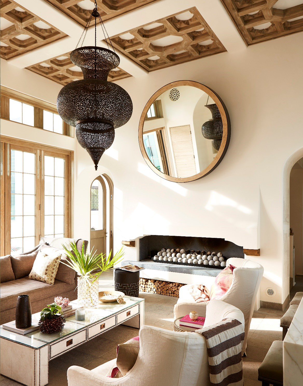 Custom details: fireplace, wood & plaster ceiling, and Moroccan light at Living by Khoury & Vogt Architects