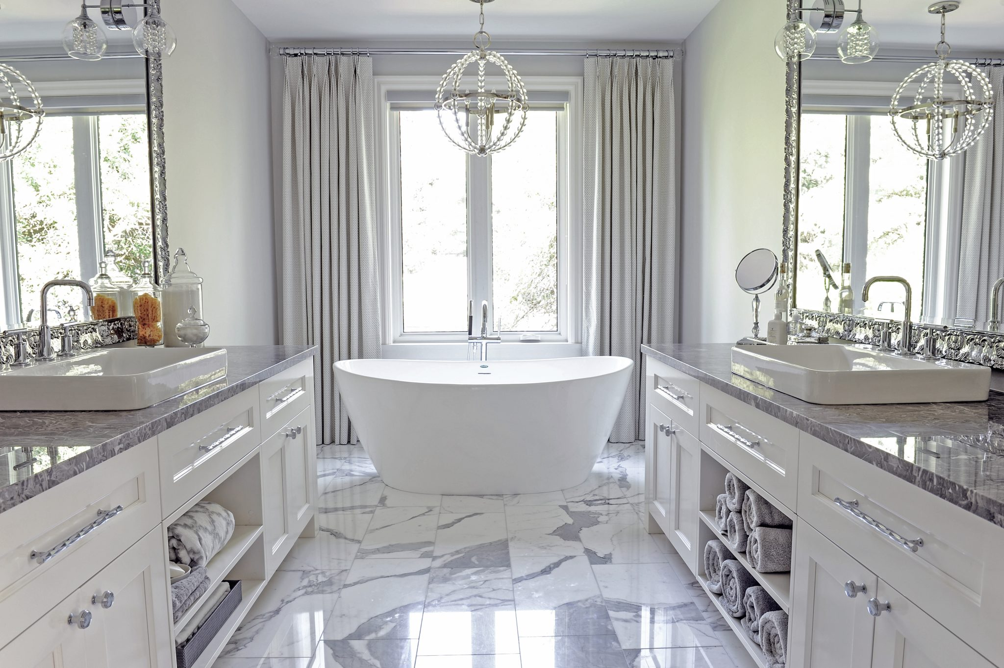 Bright Vancouver master bath with dual vanities by Enviable Designs