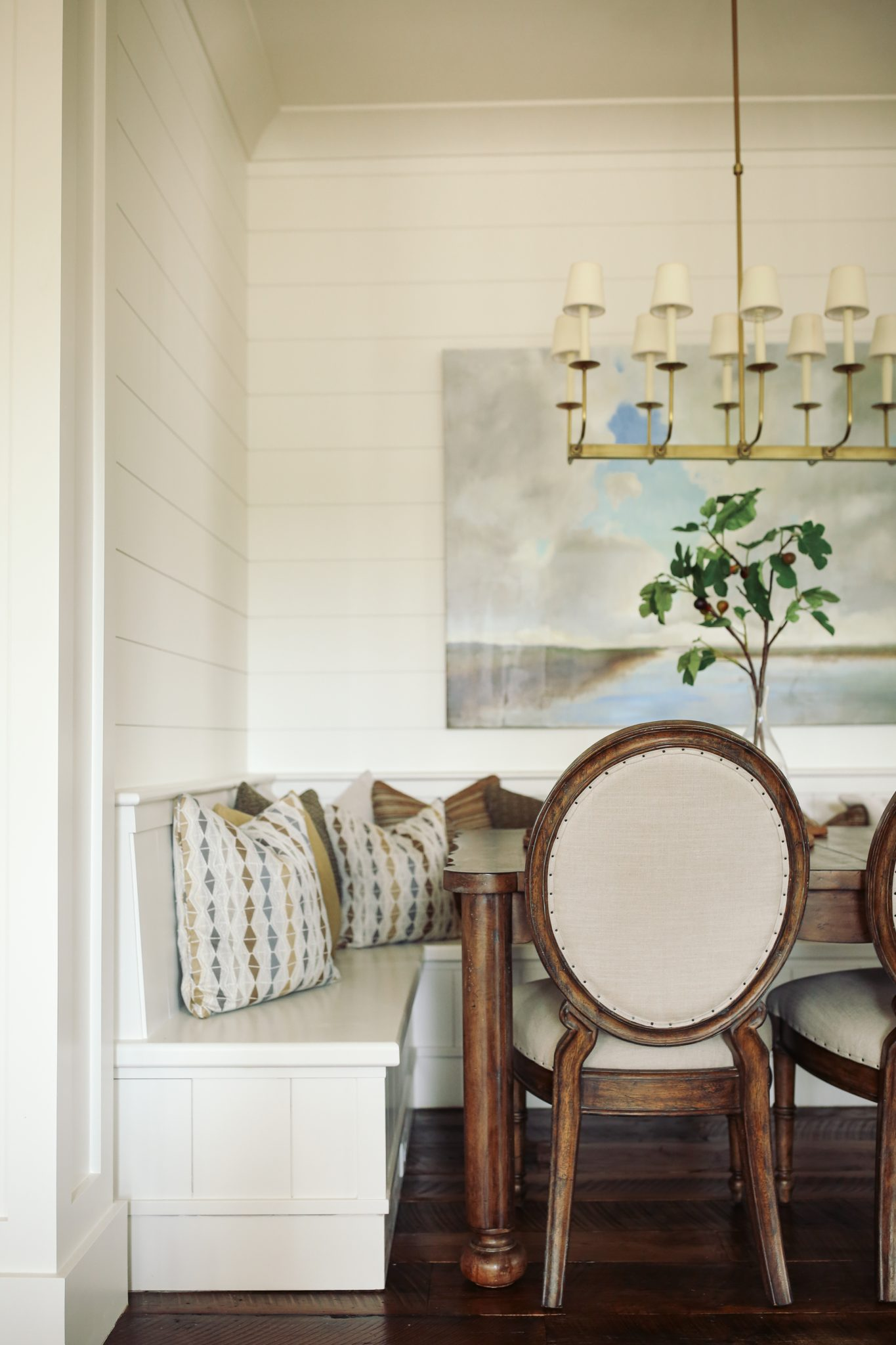 A blend of traditional chairs and built-in seating for a rustic breakfast nook by J Banks Design