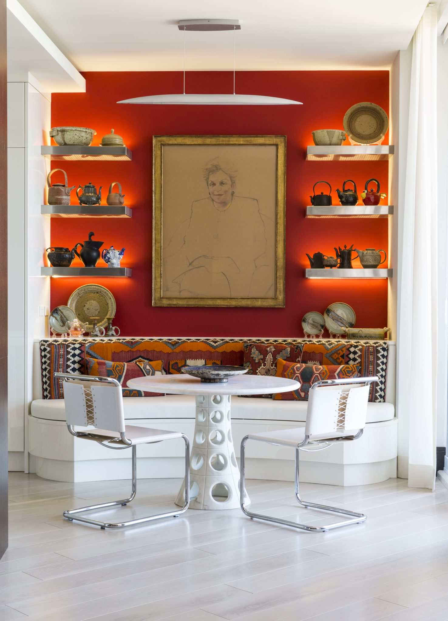 The owner's portrait presides over the breakfast area's banquette. By Taylor & Taylor