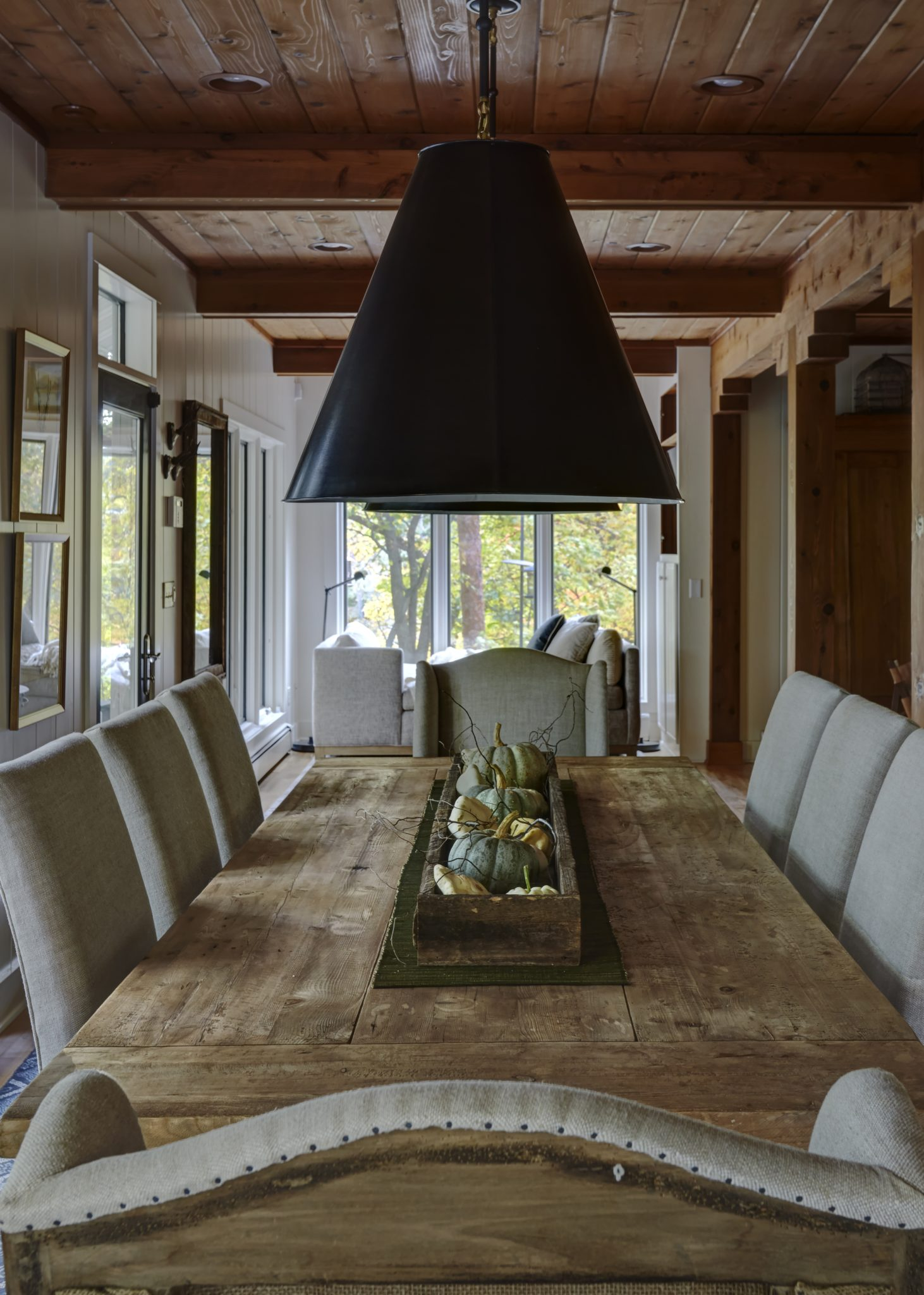 A rustic wood dining table creates comfort and charm for everyone. By Schlagenhaft Studio
