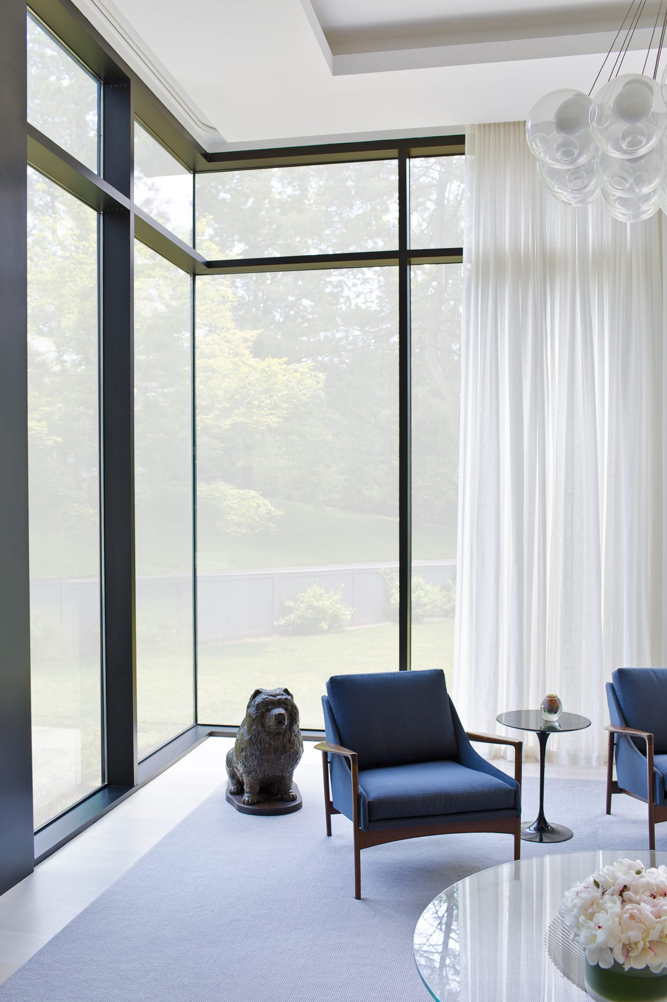 Large scale modernist windows in living room by Alisberg Parker Architects