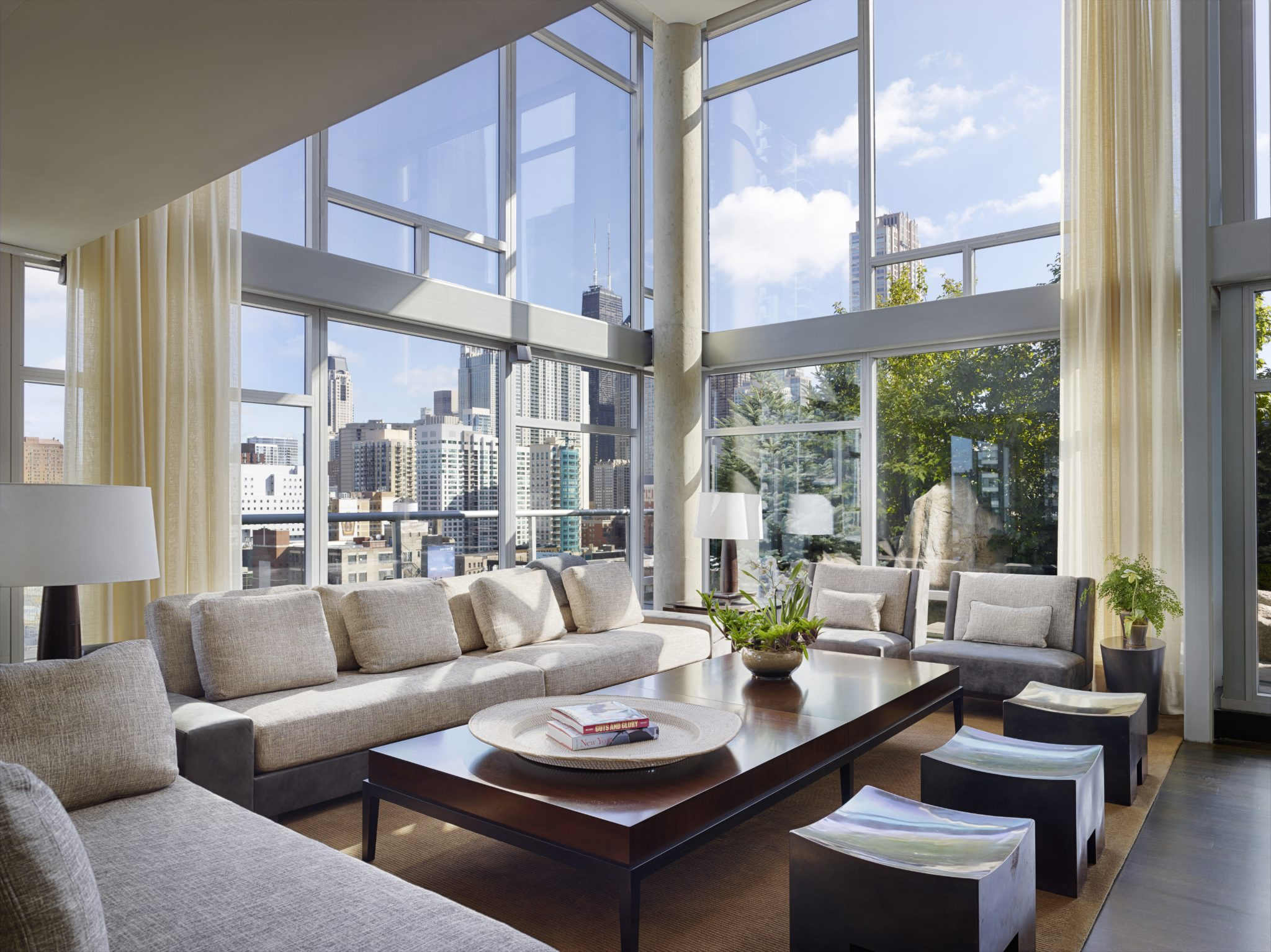 Penthouse apartment with floor-to-ceiling windows and custom sheers by Alan Design Studio