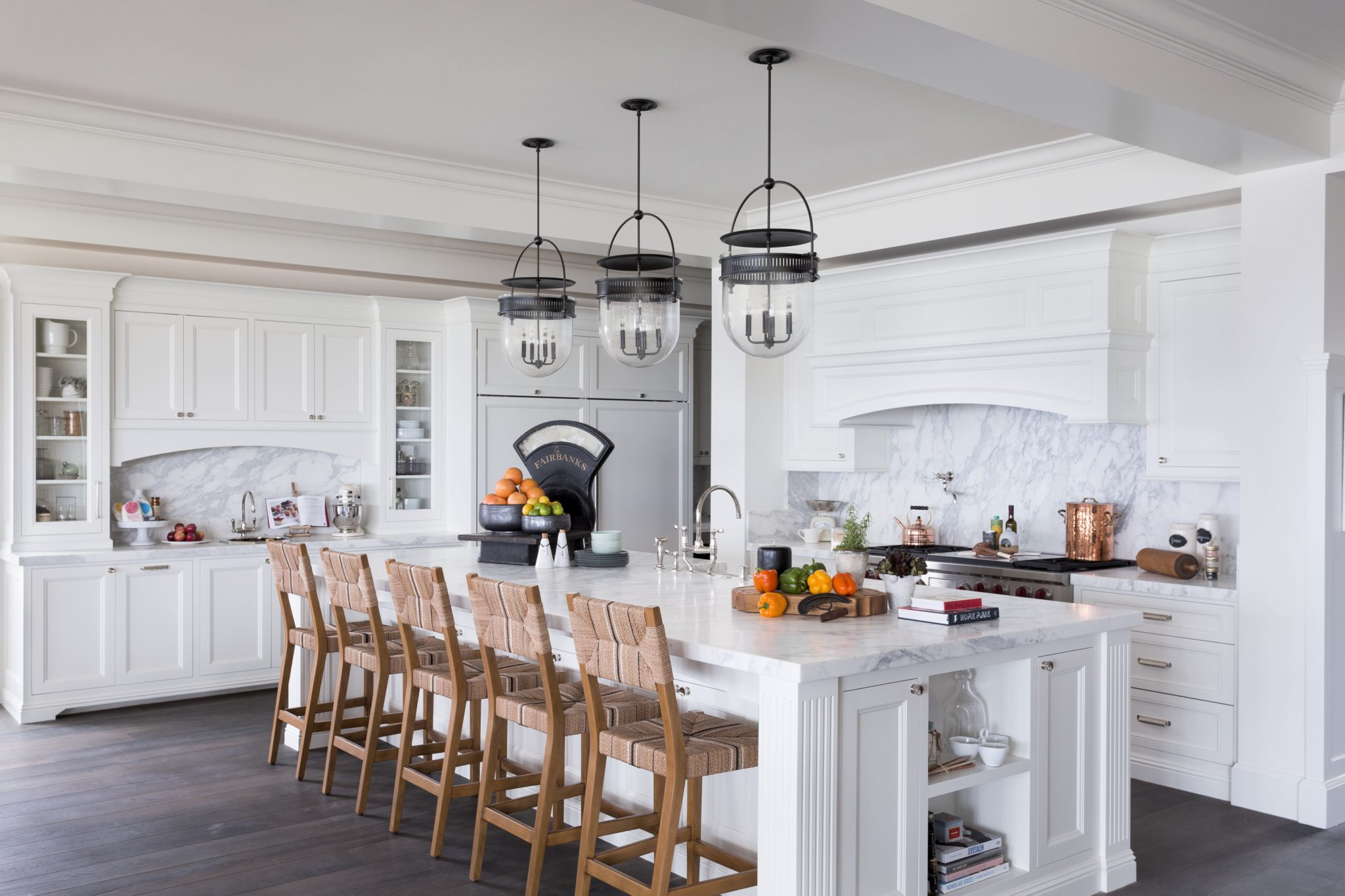 Kitchen with eat-in island by Brown Design Group