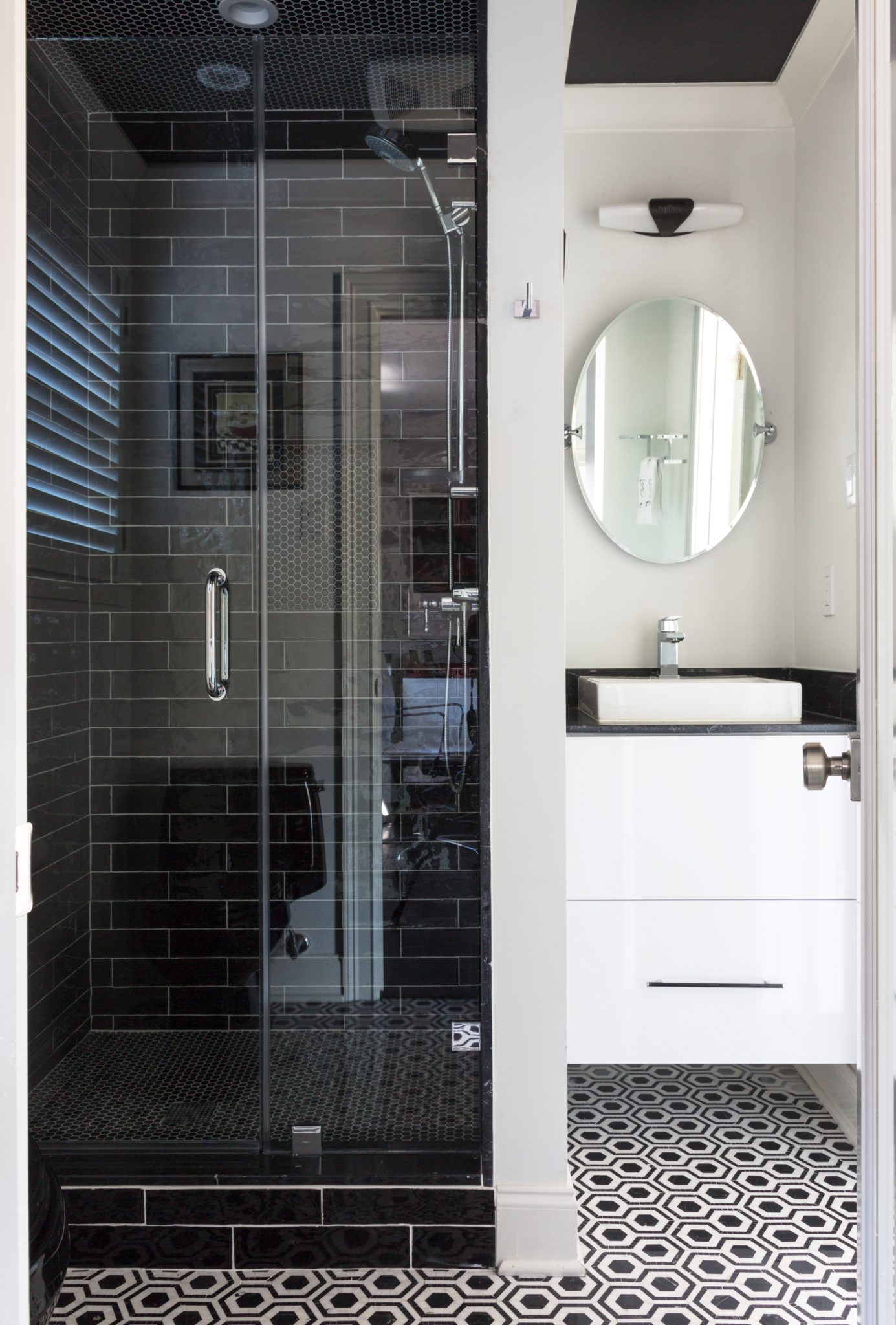 Guest Bathroom with marble flooring and glazed ceramic on shower walls by Eclectic Home
