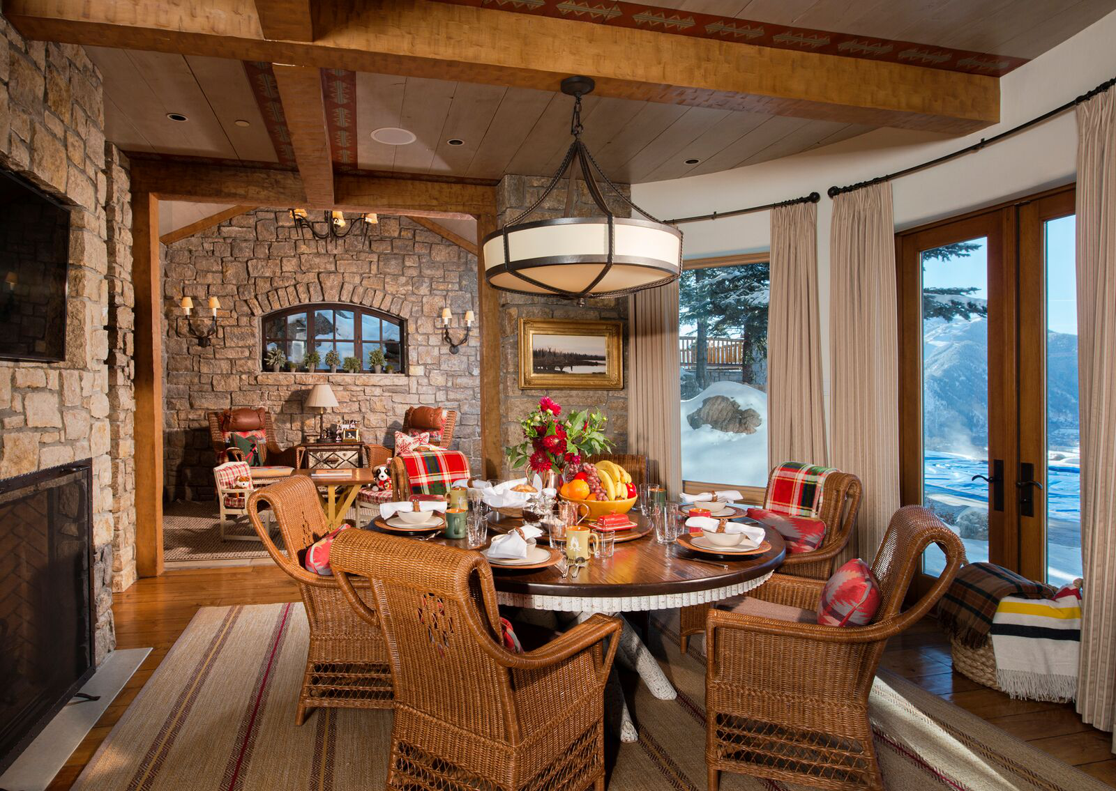 Casual family dining room adjacent to the kitchen. La Lune dining table, Mimi London dining chairs, and an Elizabeth Eakins area rug ina cozy room for a busy family. By Kevin Corn Design