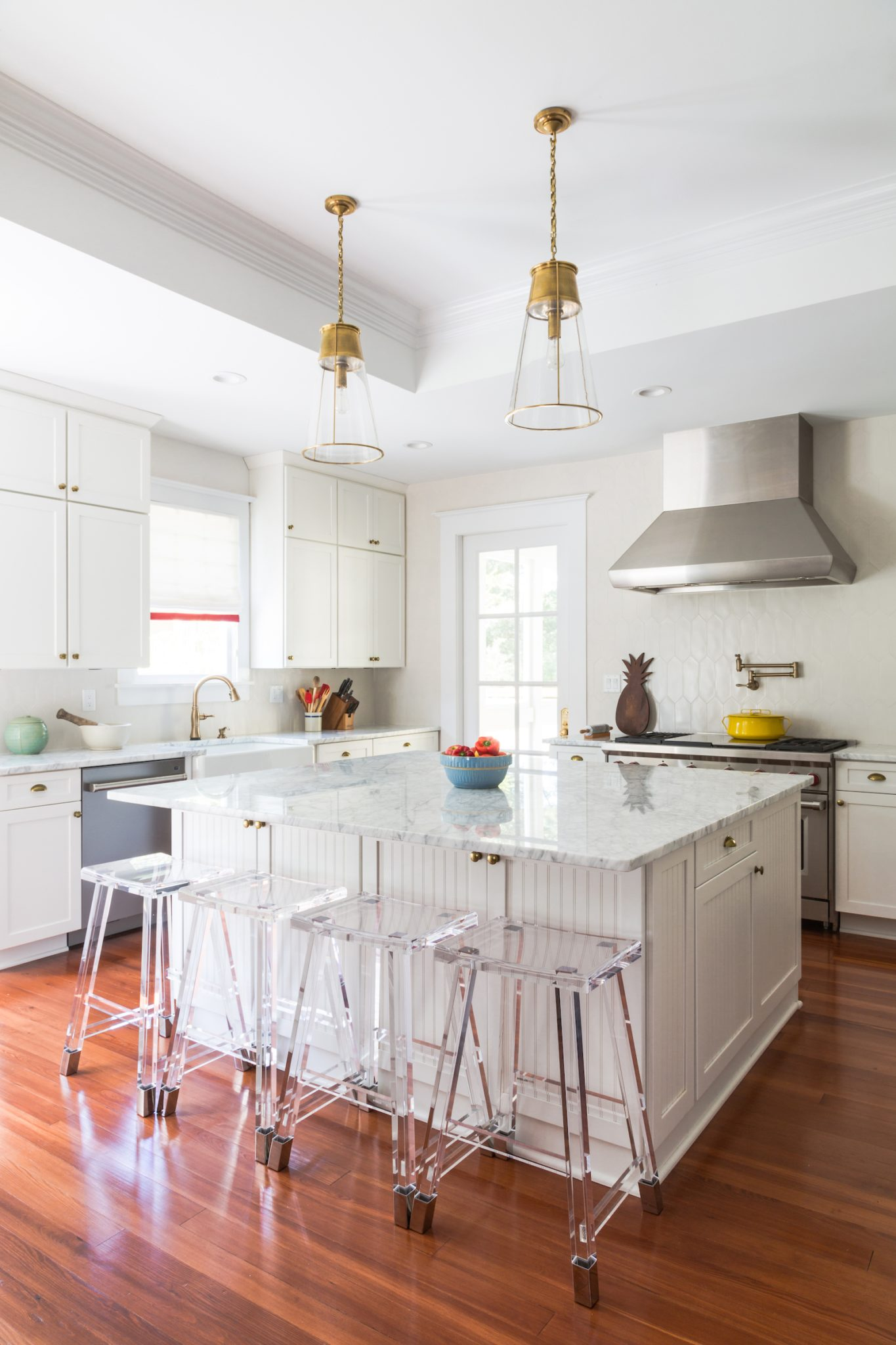 All white kitchen with custom cabinetry and geometric ceramic backsplash by Eclectic Home