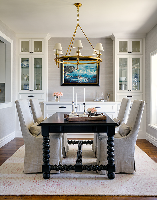 Dining room with a statement chandelier and table by Marianne Simon Design