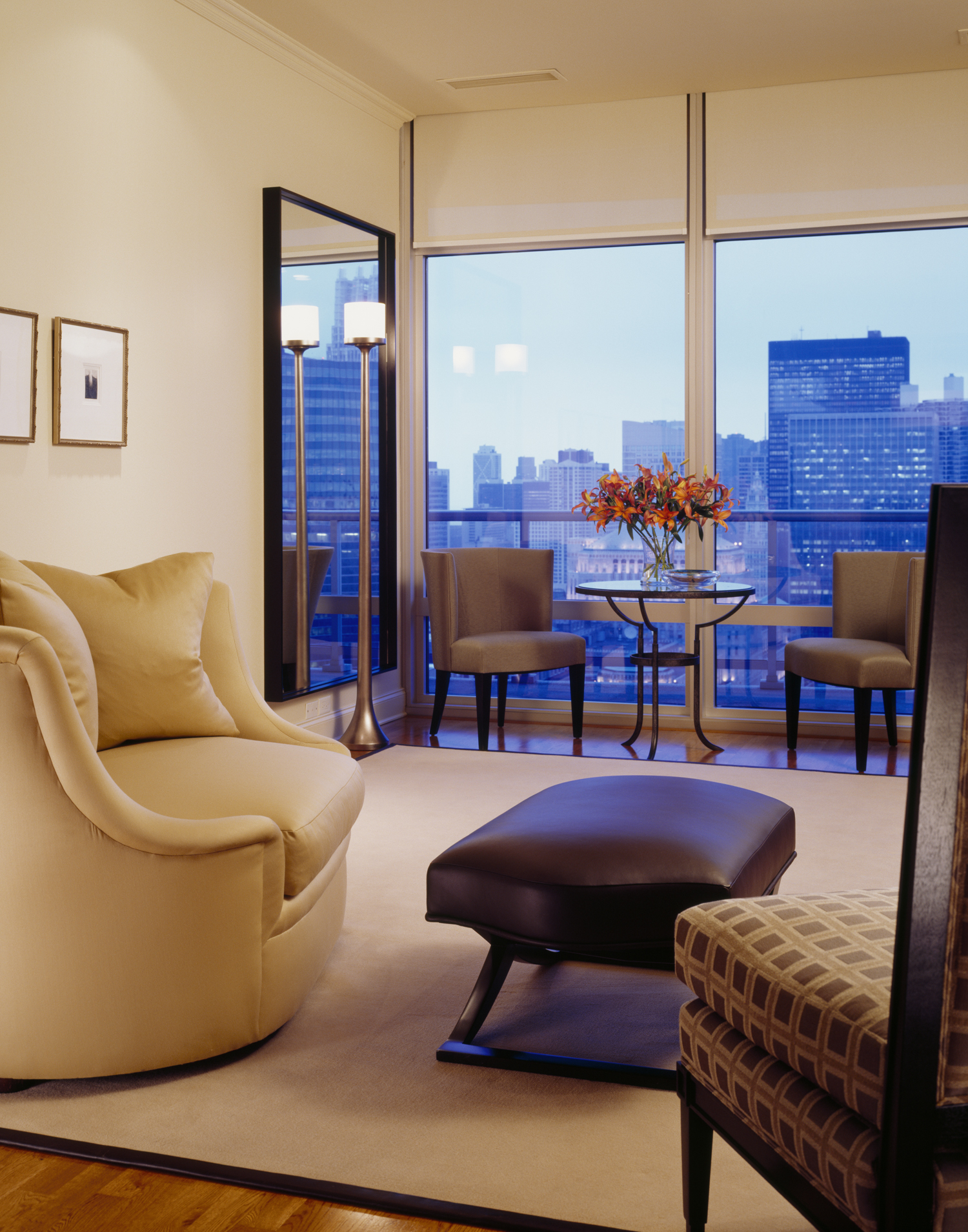 Sleek River North - living room by Mitchell Channon Design