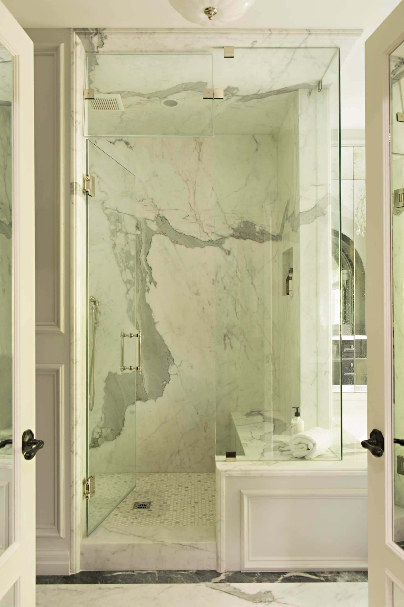 Master Bathroom shower with white marble slabs by Jackson Paige Interiors
