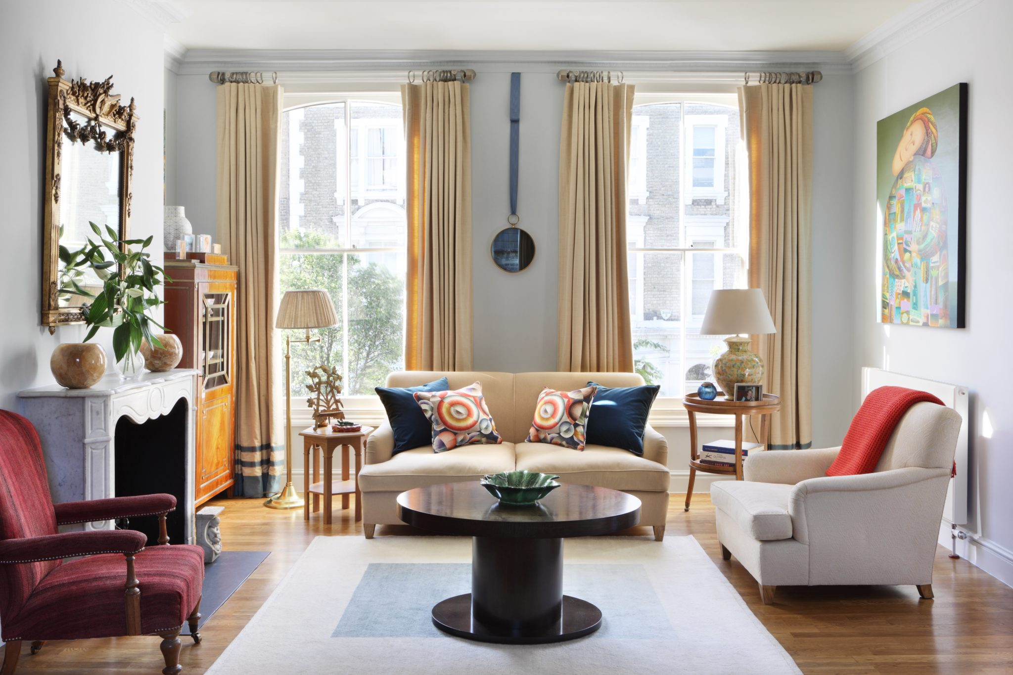 A chic living room with floor-to-ceiling windows by Salvesen Graham