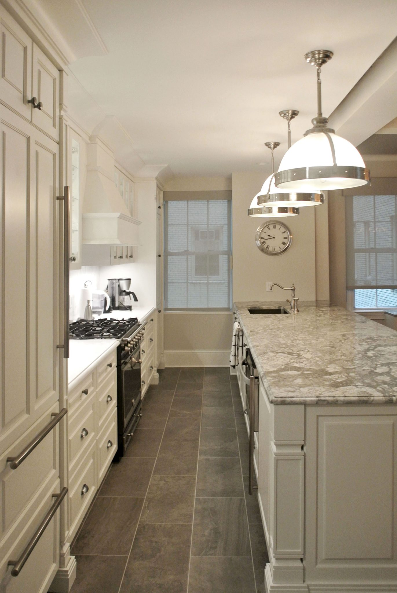 Beautiful pre-war kitchen transformation with custom island and cabinets by Paula McDonald Design Build & Interiors