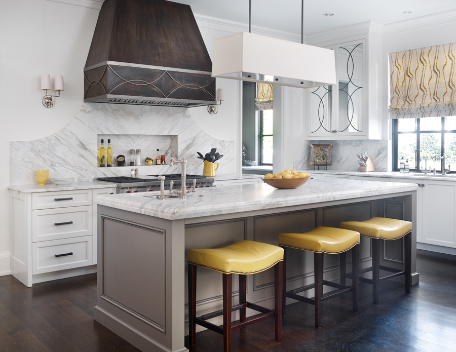 Pops of yellow in a kitchen by The Design Atelier