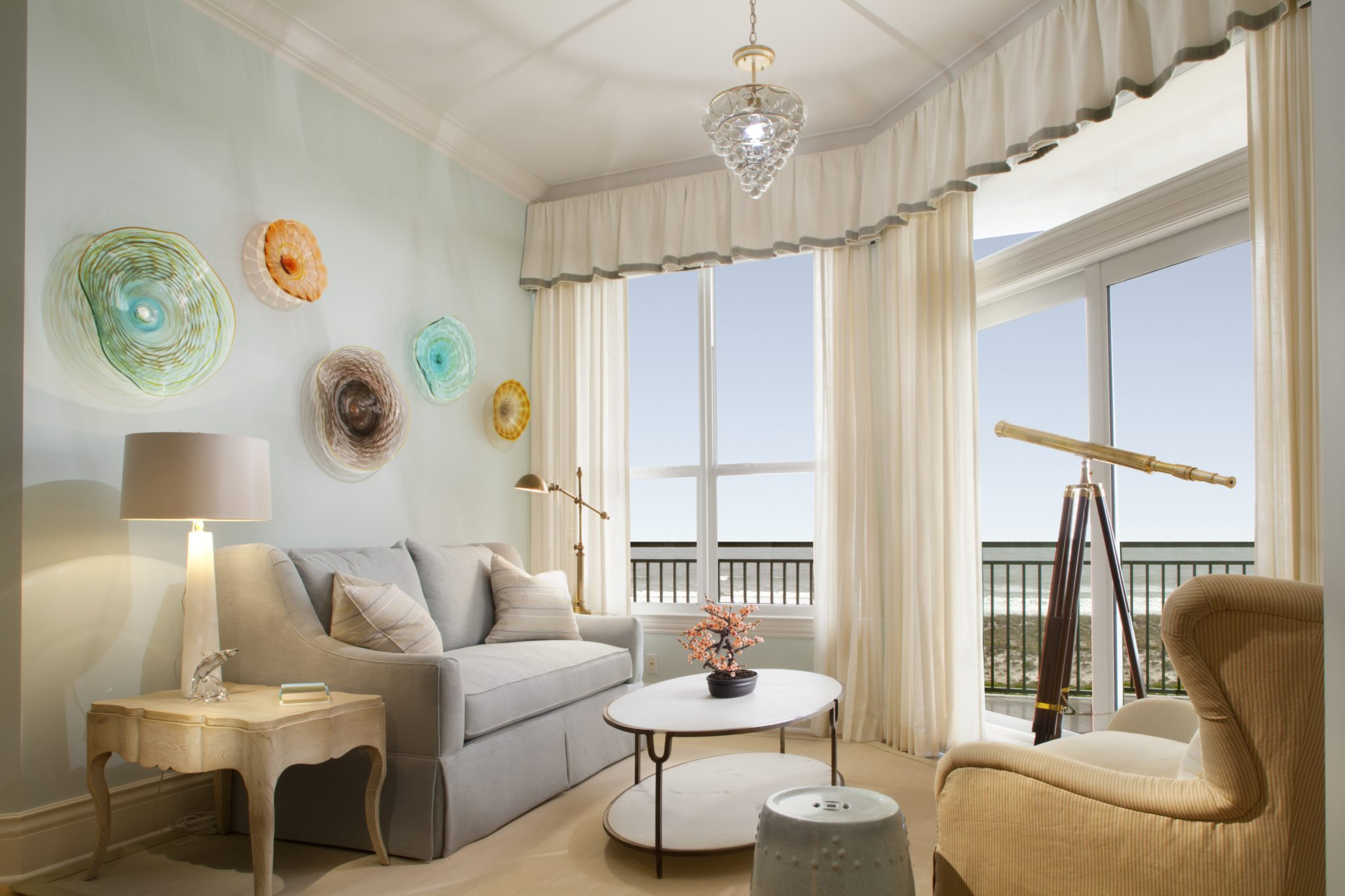 Coastal cottage condo master sitting room by Amanda Webster Design, Inc.