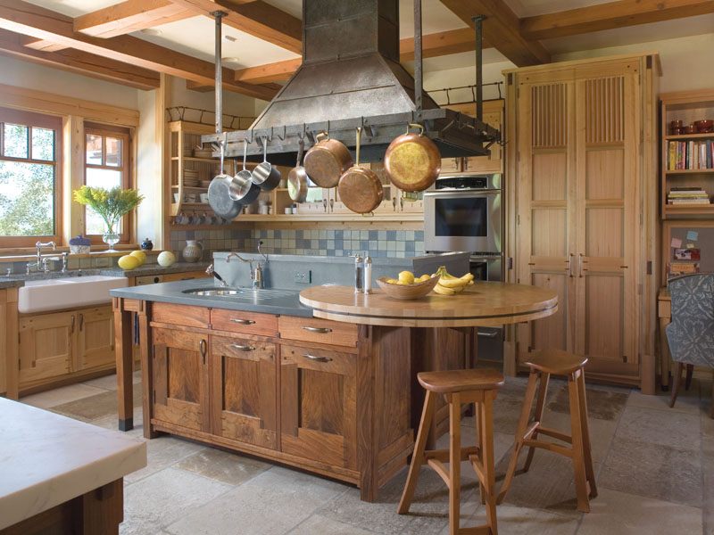 Aspen kitchen with antique chateau stone tile flooring by Staprans Design
