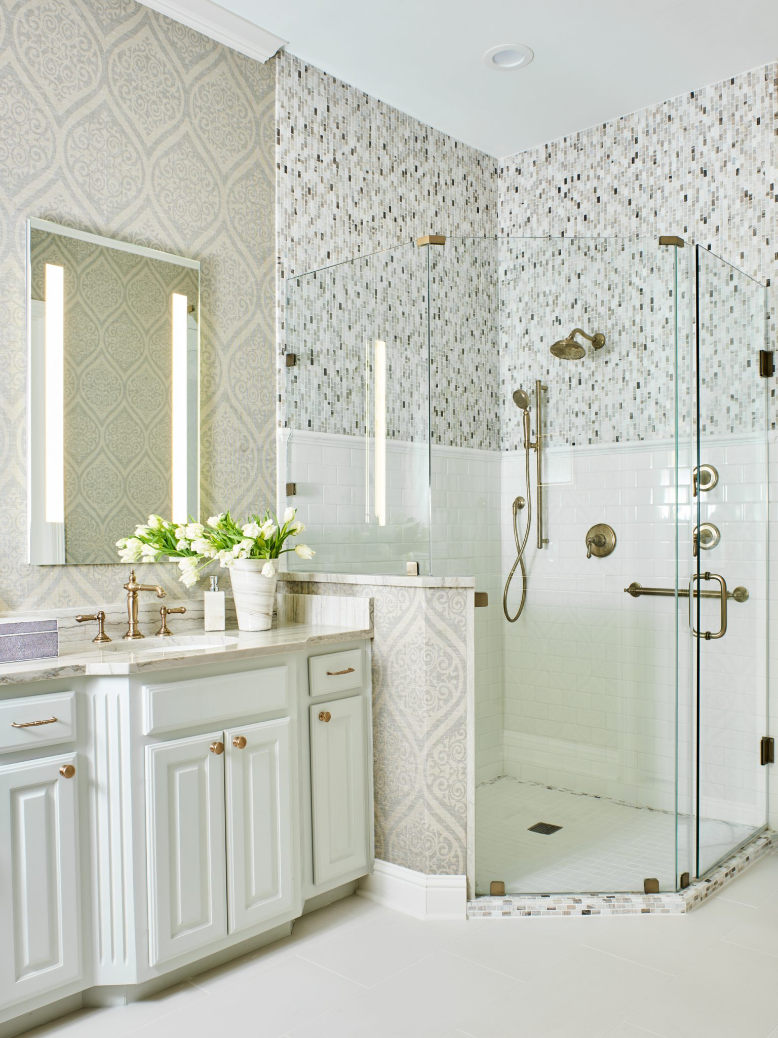 Master Bath Featuring Wallpaper & Tile by Denise McGaha Interiors