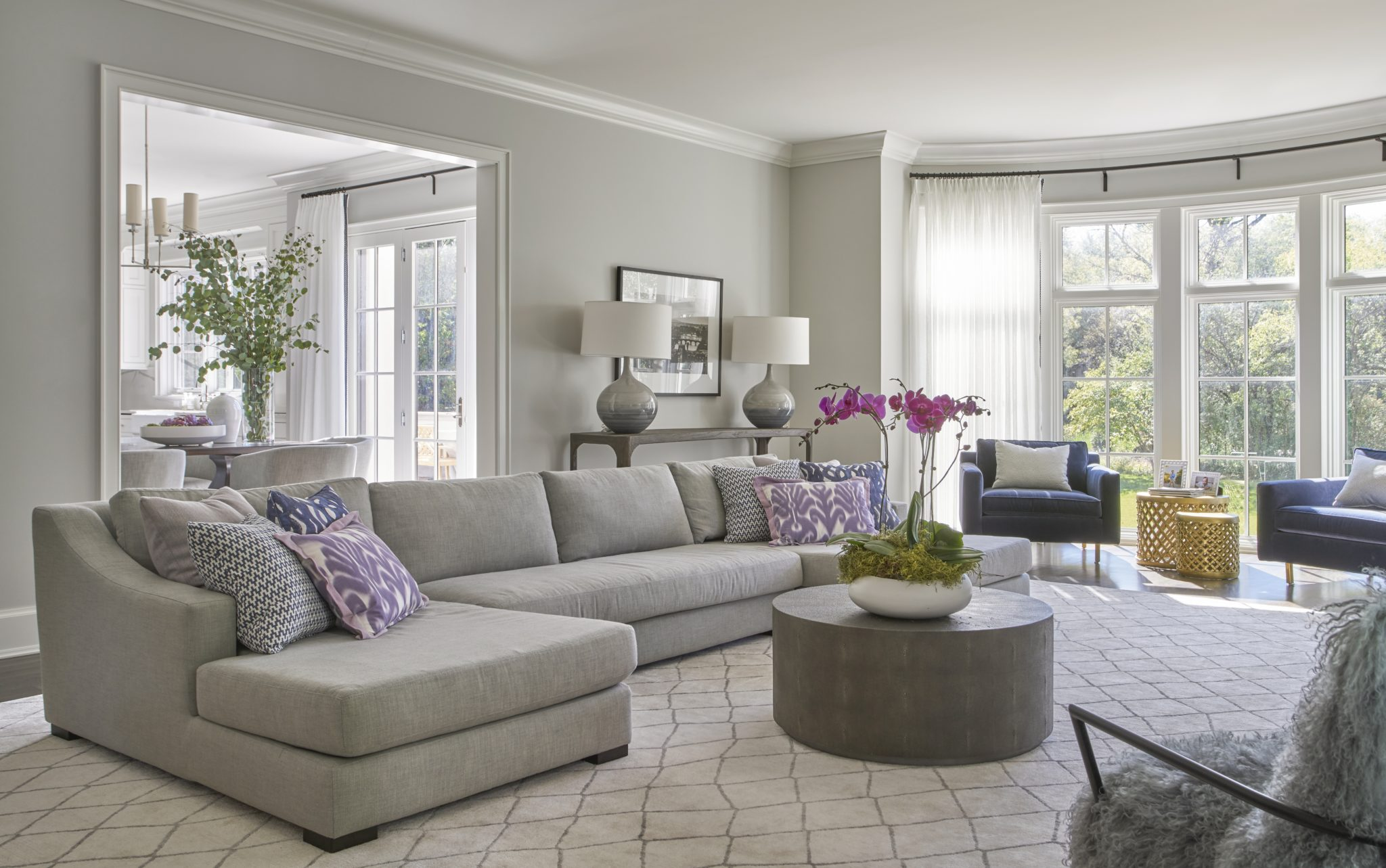 Winnetka home, styled family room with ample seating and fun accessories. by Elizabeth Krueger Design