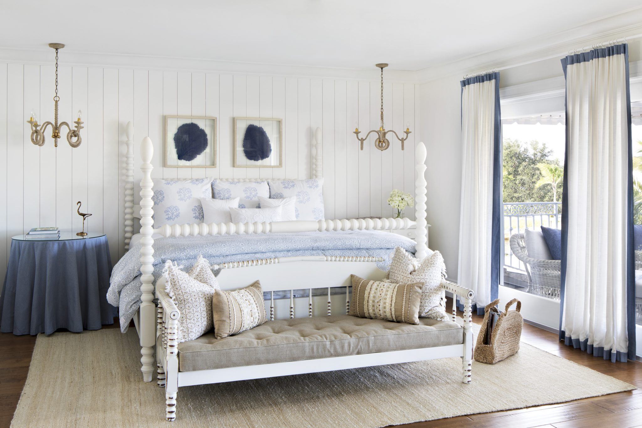 Master bedroom with shiplap wall and antique bench by Lisa Michael Interiors