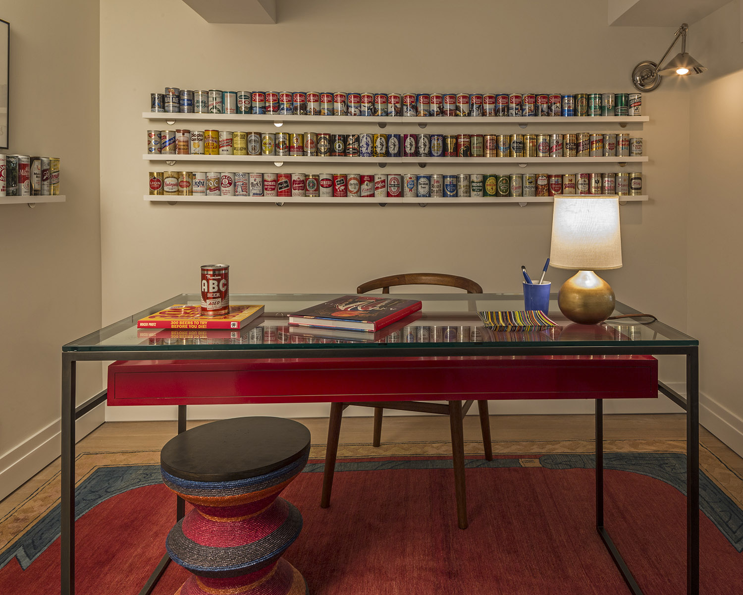 A total of 145 1970s beer cans are the backdrop for this modern home office. By Scott Sanders