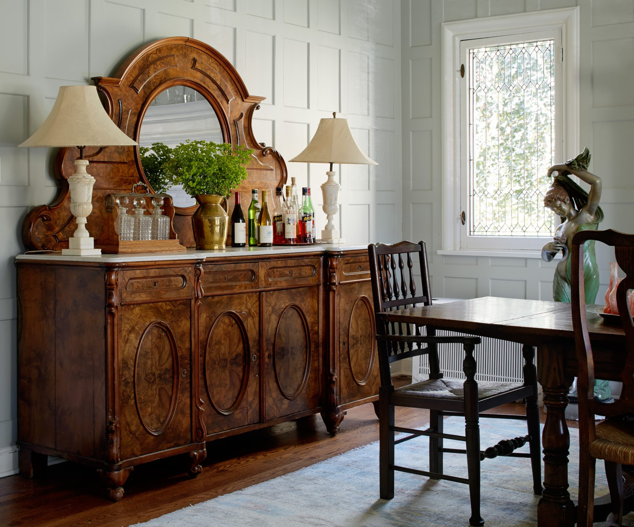 Sheridan Road Dining Room with Gray Paneled Walls and Burled Wood Bar by 2to5 Design