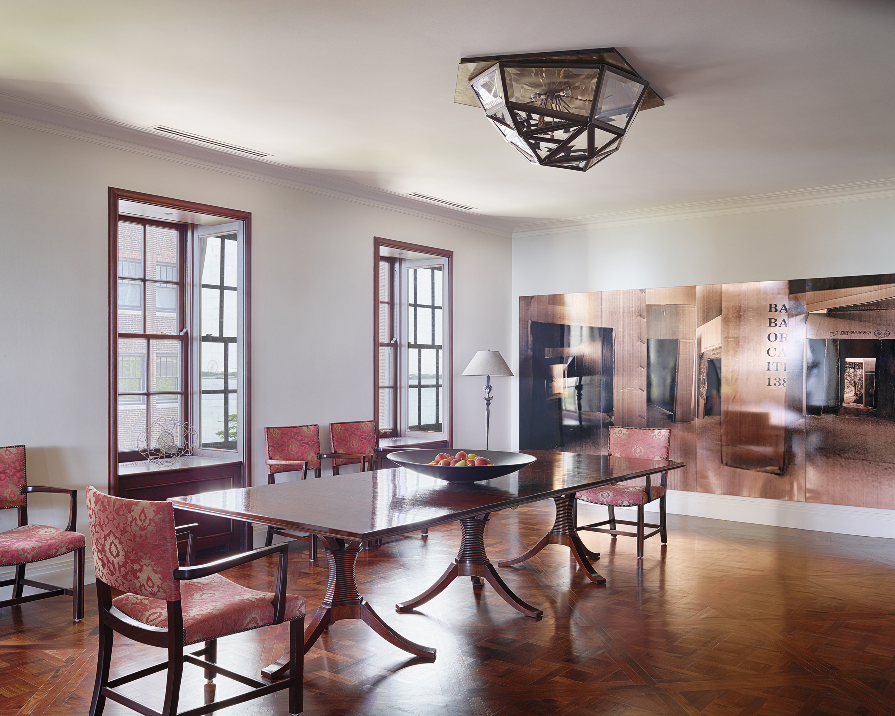 A corset dining table andDessin Fournir chairs complemented by parquet flooring by Alan Design Studio