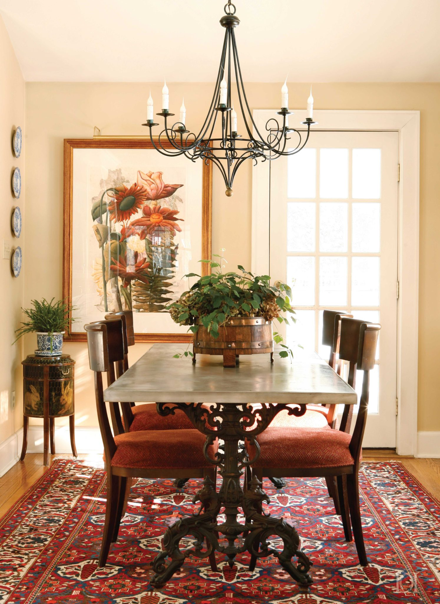 Cottage dining room with an antique table by Deborah Leamann Interior Design