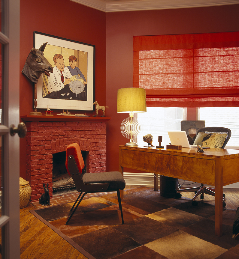 Chinese red wall and Roman shade complemented by a checkered hide rug by Alan Design Studio