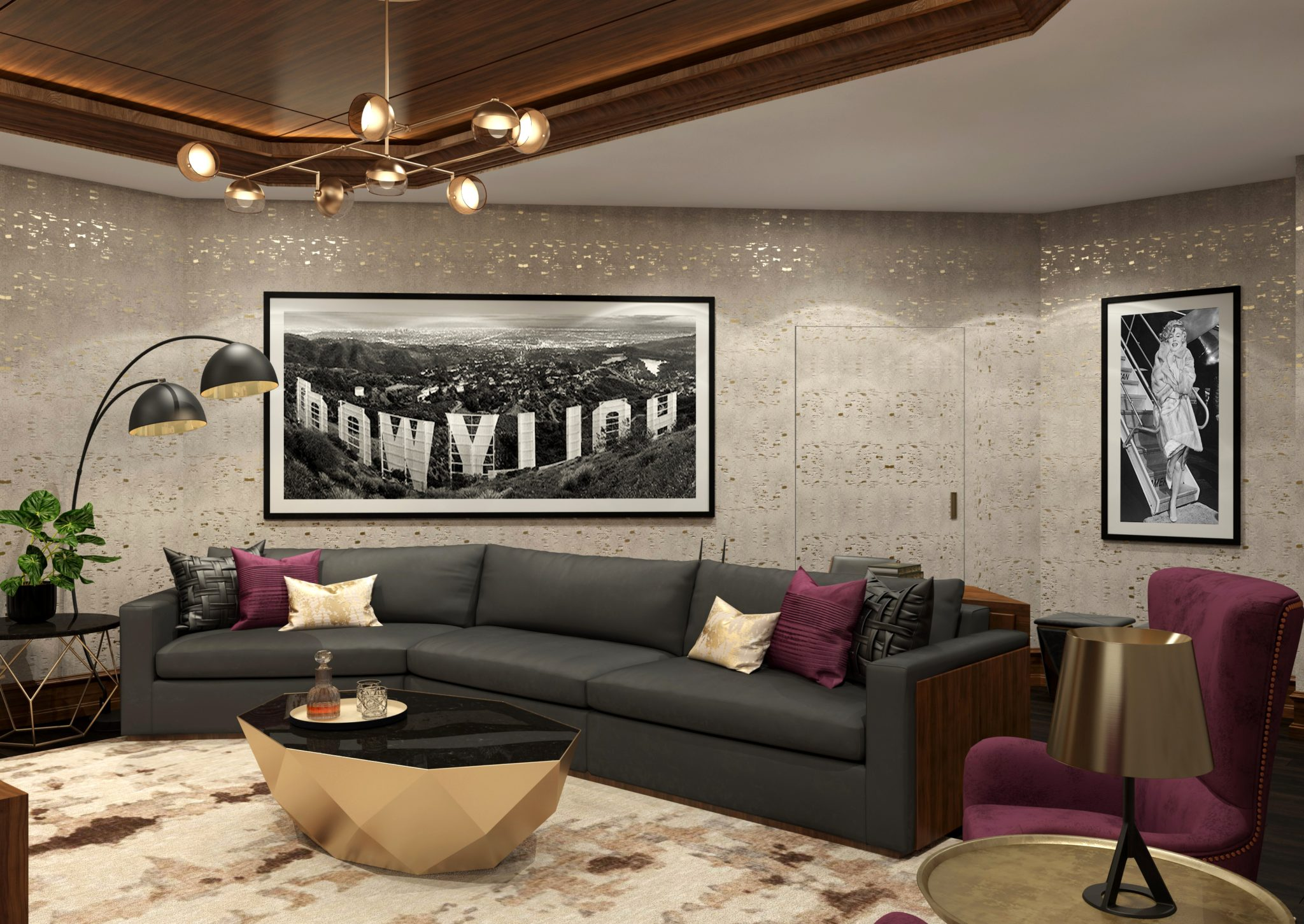 The curved grey upholstered sofa is complemented by the black and white photo. by Gil Walsh Interiors