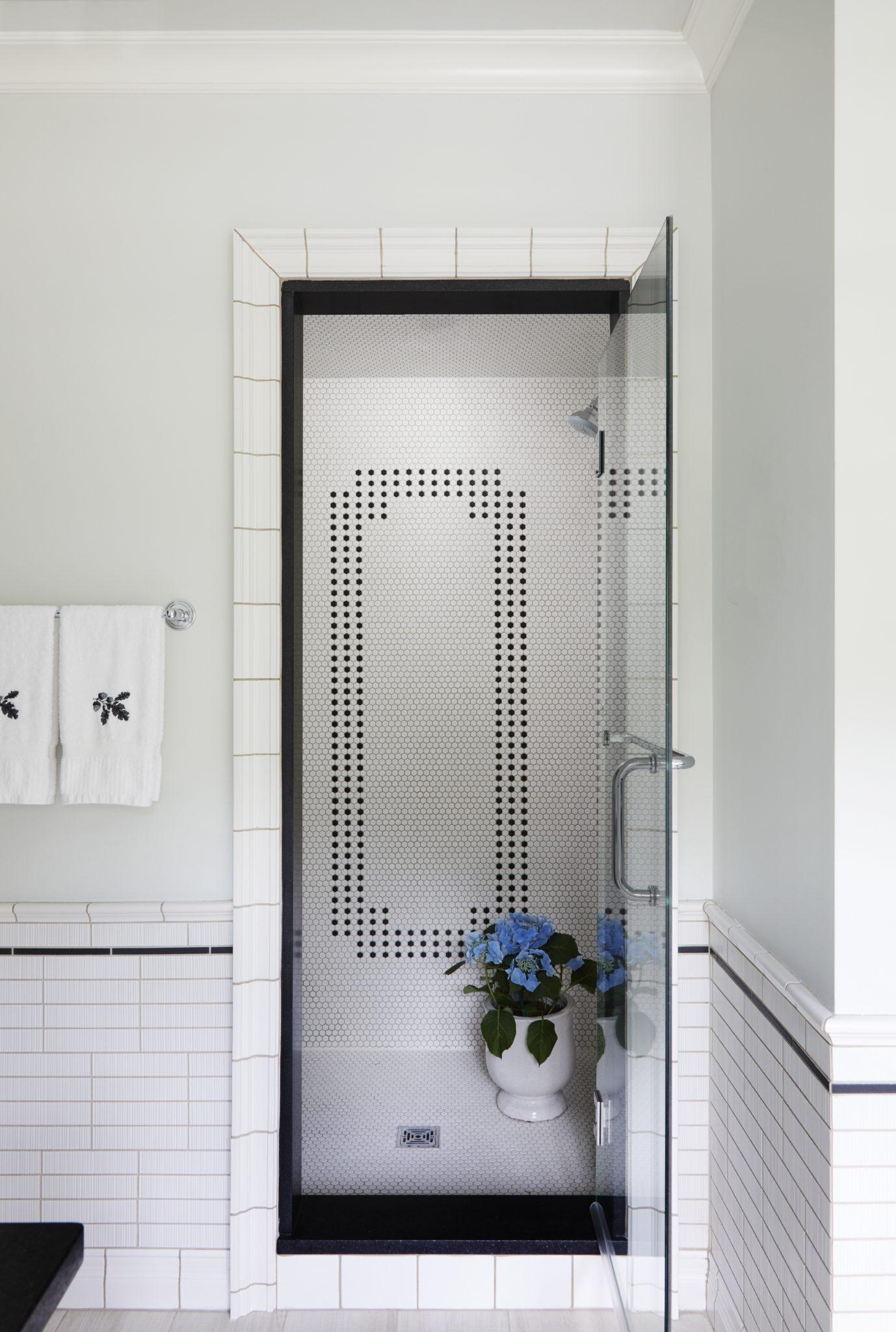 Black & white vintage tile design, mini hex patterned shower wall for guest bath by Elizabeth Drake