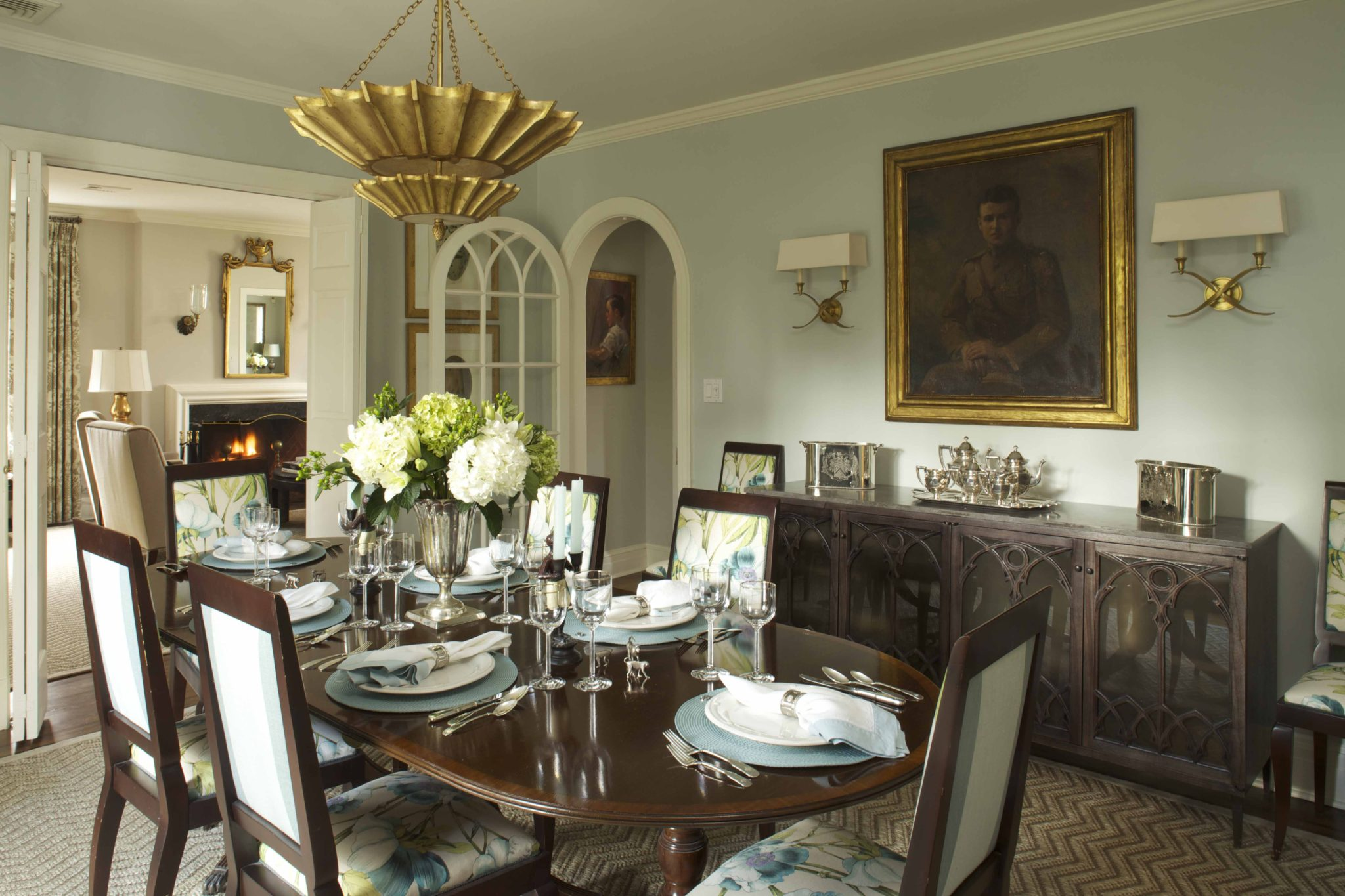 An elegant dining area, featuring an original arched French door by Ken Gemes Interiors