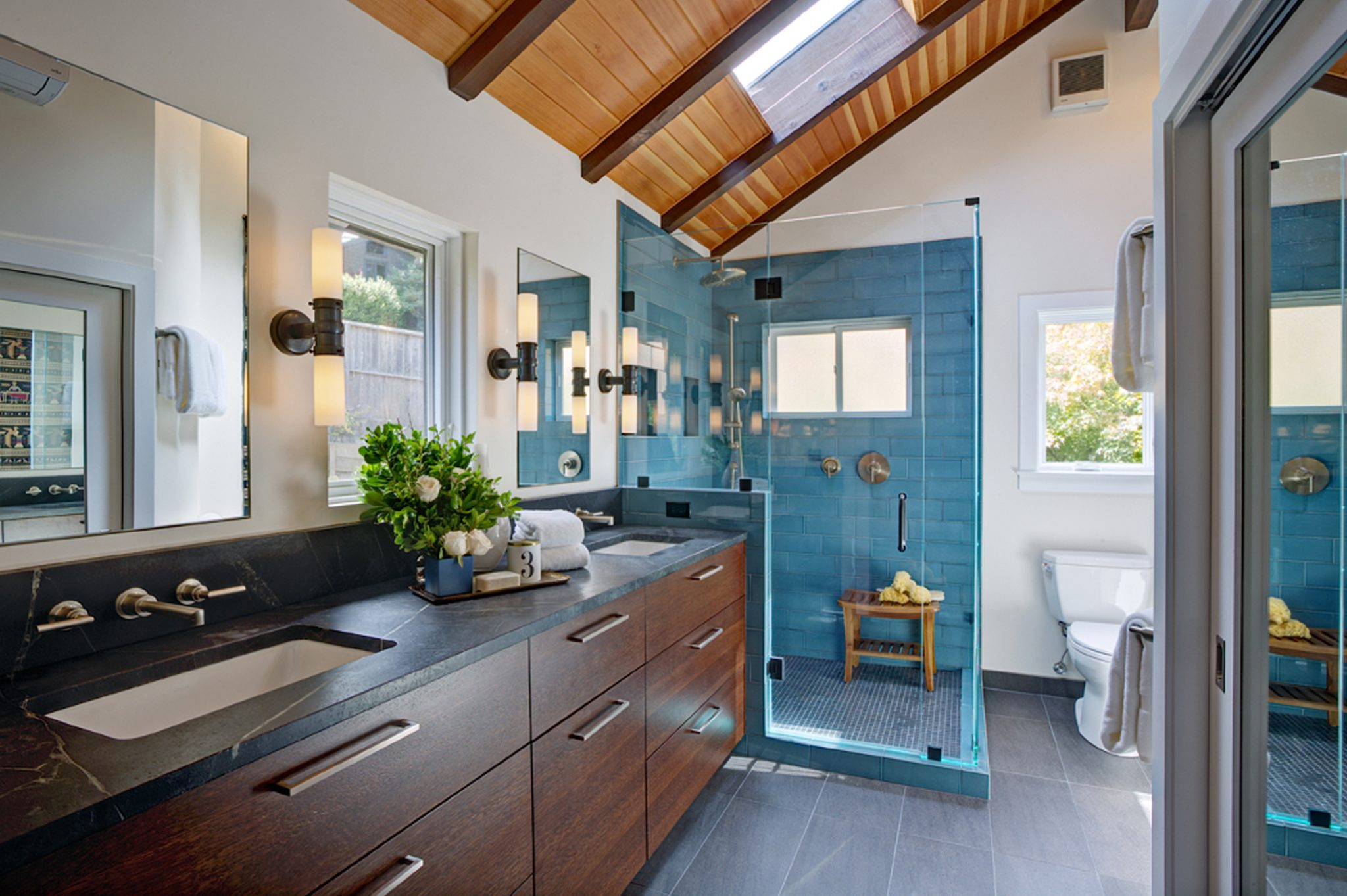 A blue shower looks serenely inviting. by Molie Malone Interior Design
