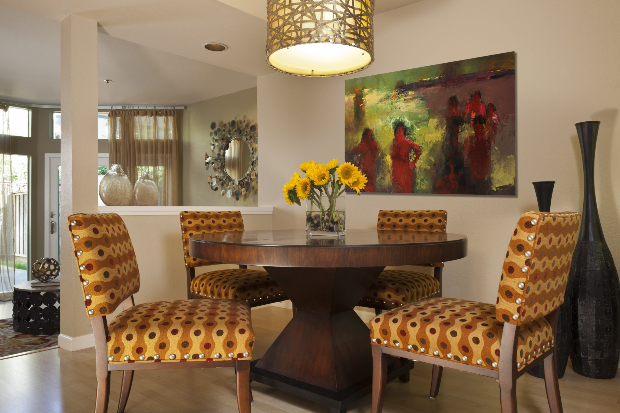 Dining room featuring around pedestal table with patterned chairs and drum pendant by Alison Whittaker Design