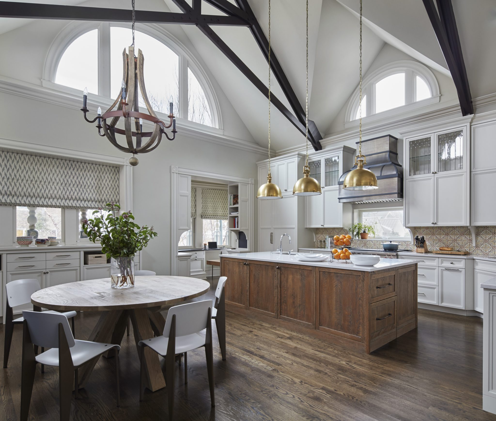 Kitchen with brass pendants and rustic wood island by 2to5 Design