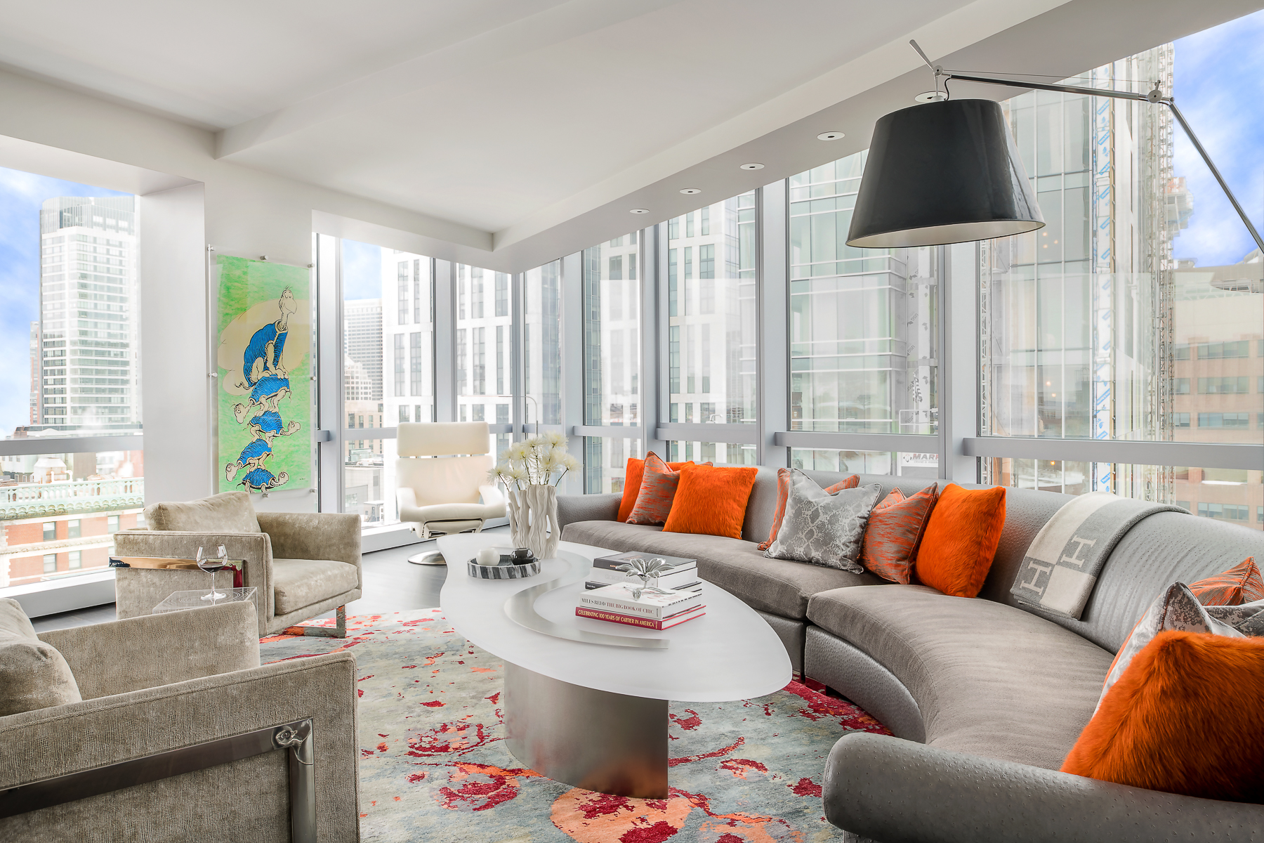 Custom curved sofa and cocktail table in living space by Eric Roseff Designs