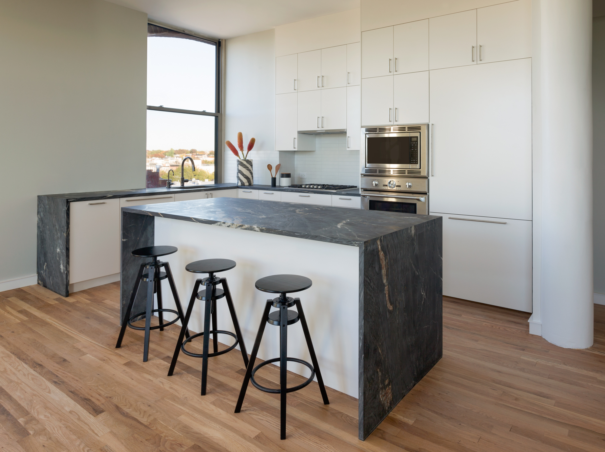 Park Slope kitchen with custom marble waterfall island by Atelier Armbruster