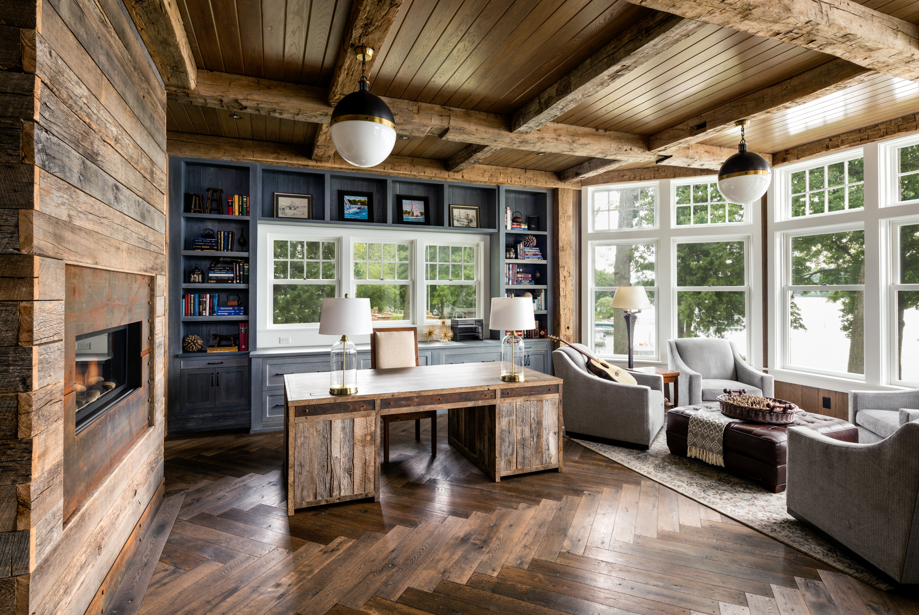 Reclaimed wooden beamed home office with a coastal view by Wade Weissmann Architecture Inc.