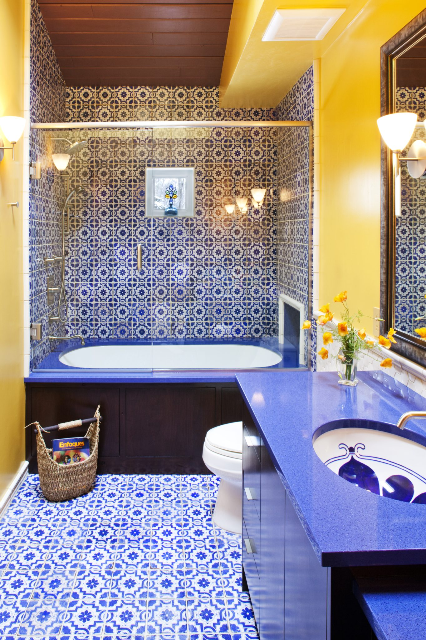 Blue and Yellow Moroccan-Inspired Guest Bathroom by Susan E. Brown Interior Design