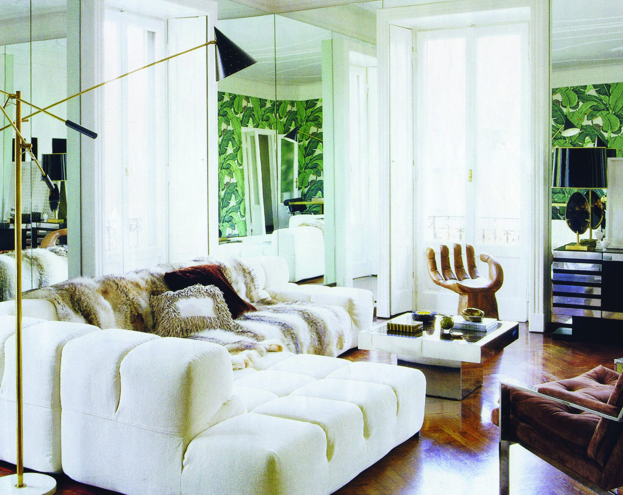 Milan. Living Room with vintage hand chair and custom sofa by Patricia Urquiola. by Nate Berkus Associates