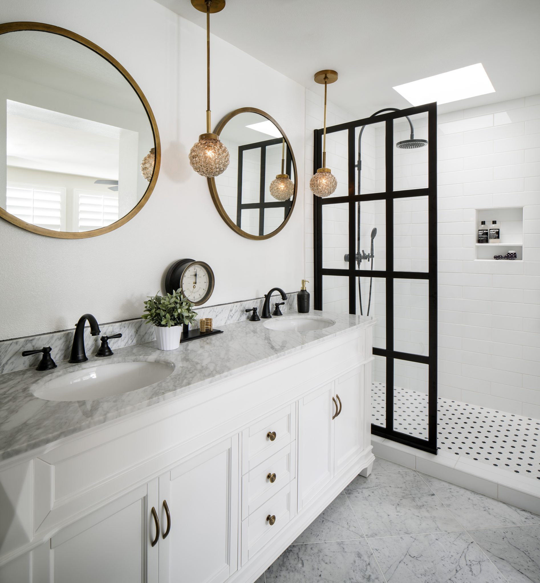 Contrast and classic elements bring drama and timelessness to this master bath. by CM Natural Designs
