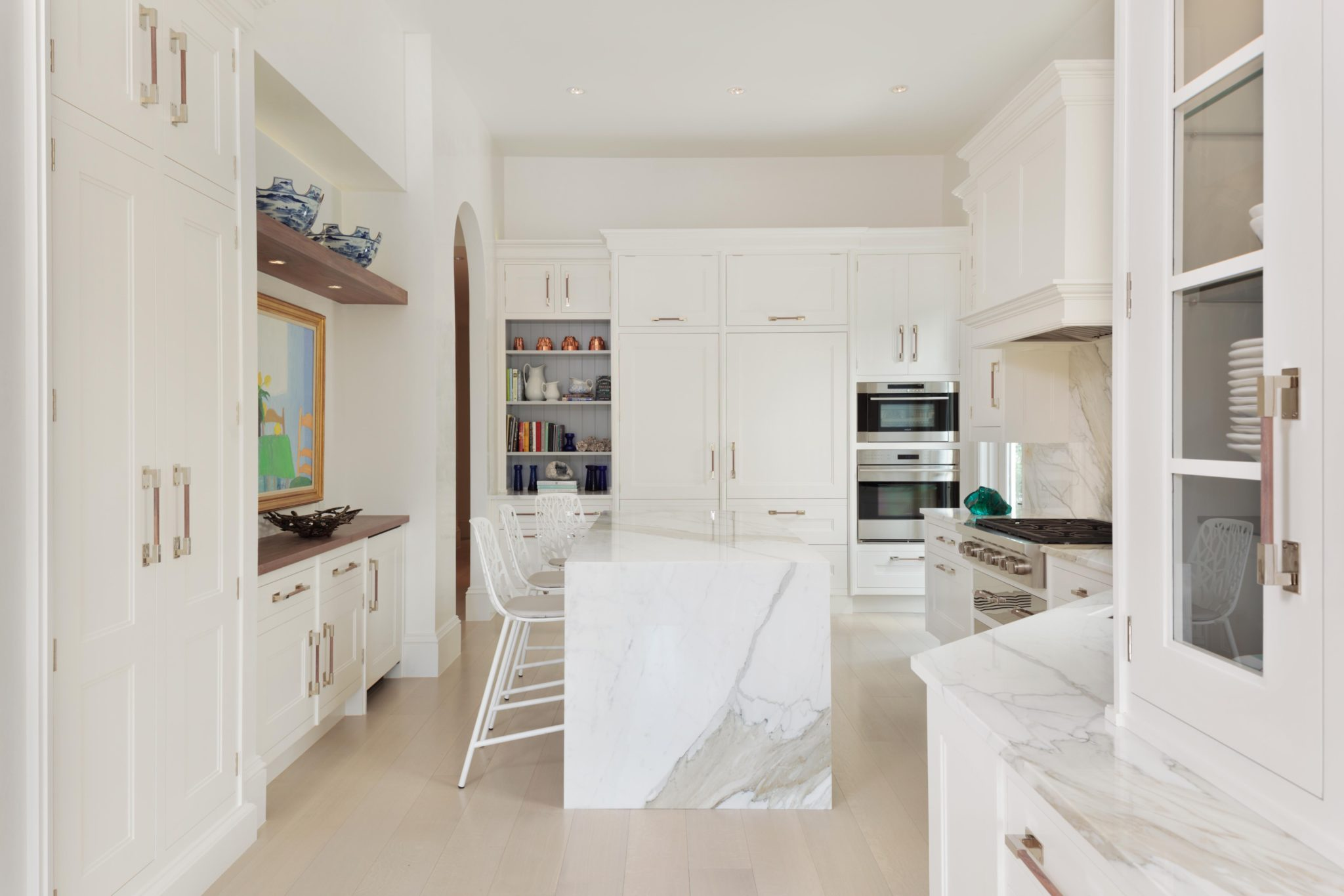 Bay Colony home renovation; fresh kitchen space housing sleek marble countertops by Judith Liegeois Designs