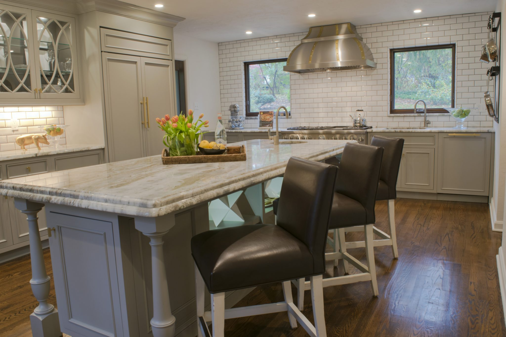 English Tudor kitchen renovation - large island fits six counter stools. By LSM Interior Design