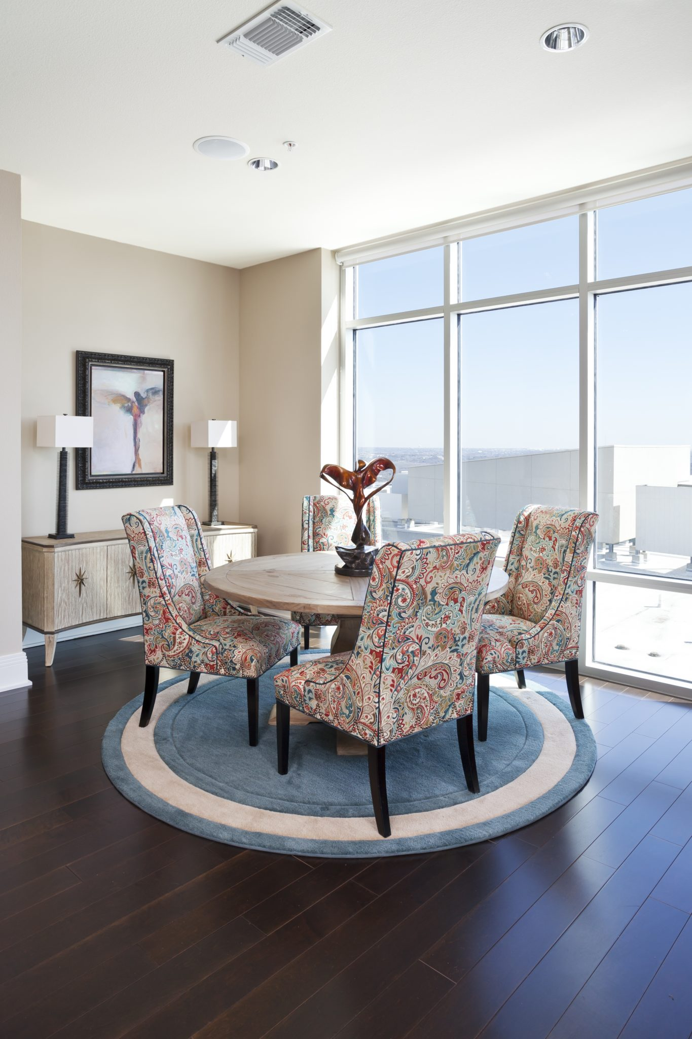Transitional high-rise dining area by Nicole Arnold Interiors