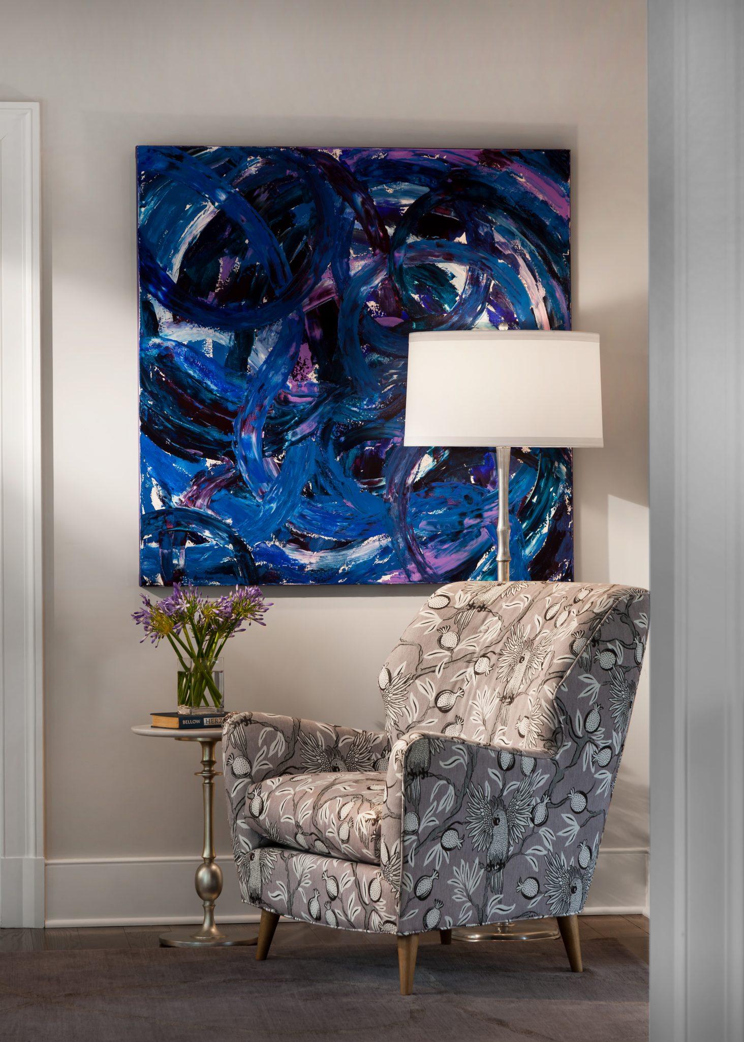 Purple Scandinavian chair with modern art by Mark P. Finlay Interiors