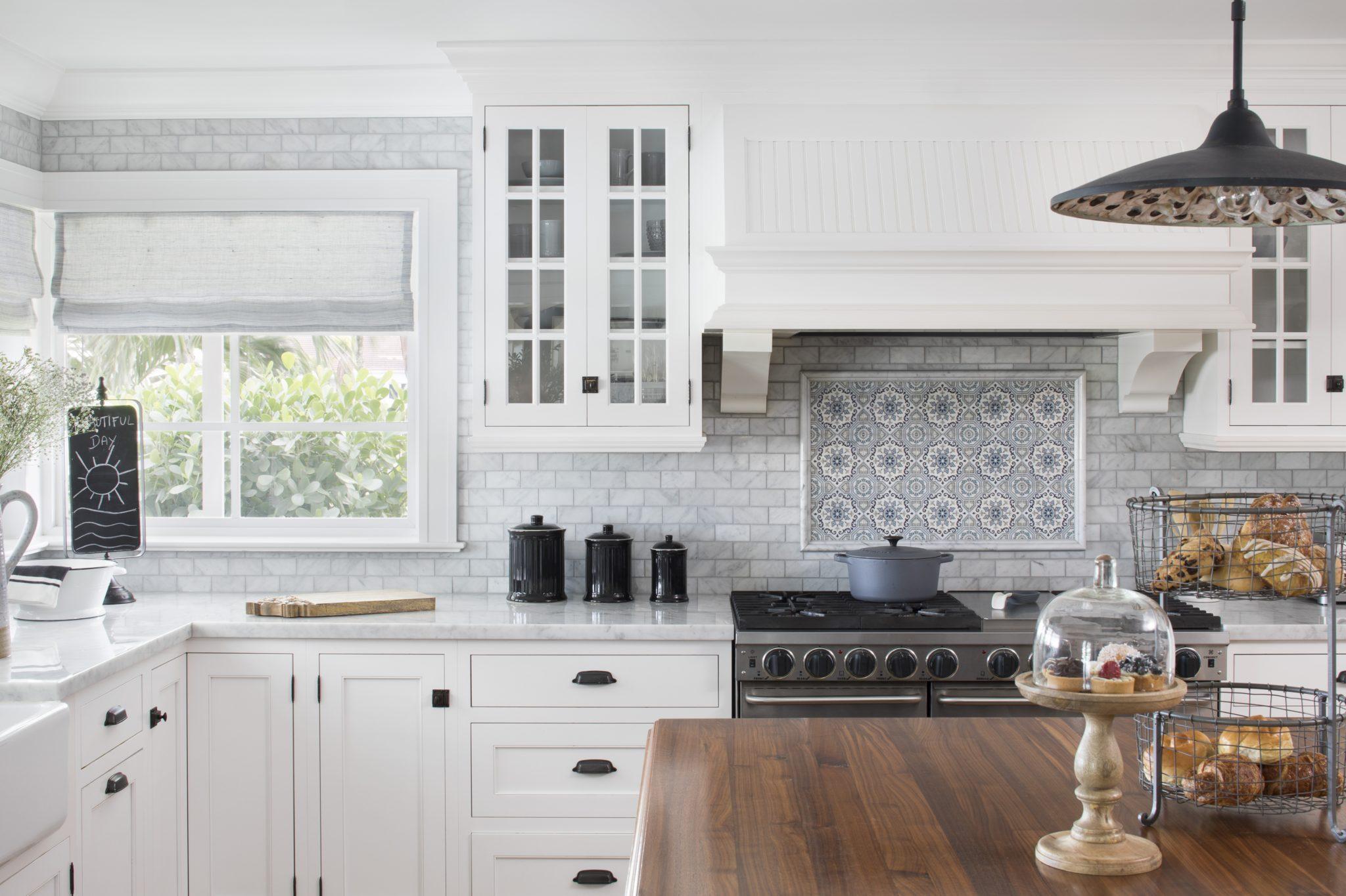 Farmhouse Coastal Kitchen with hand painted carrara marble backsplash by Lisa Michael Interiors