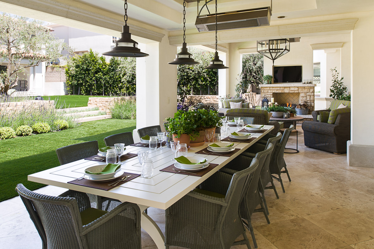 Outdoor dining room with a custom McKinnon and Harris dining table and Janus et Cie dining chairs by Kevin Corn Design