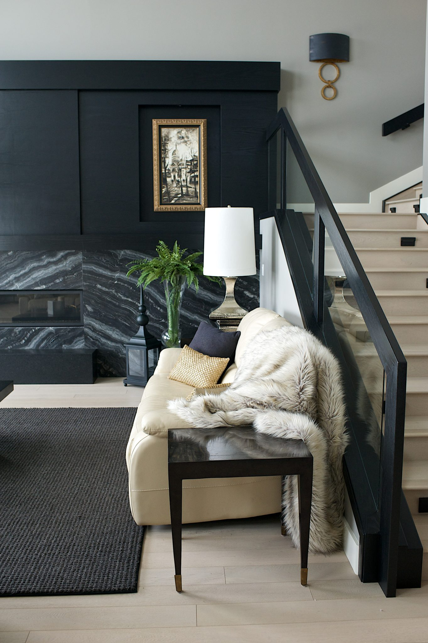Modern Steam Punk fireplace and stairwell, black and wire brushed oak details by Marie Hebson's interiorsBYDESIGNinc.
