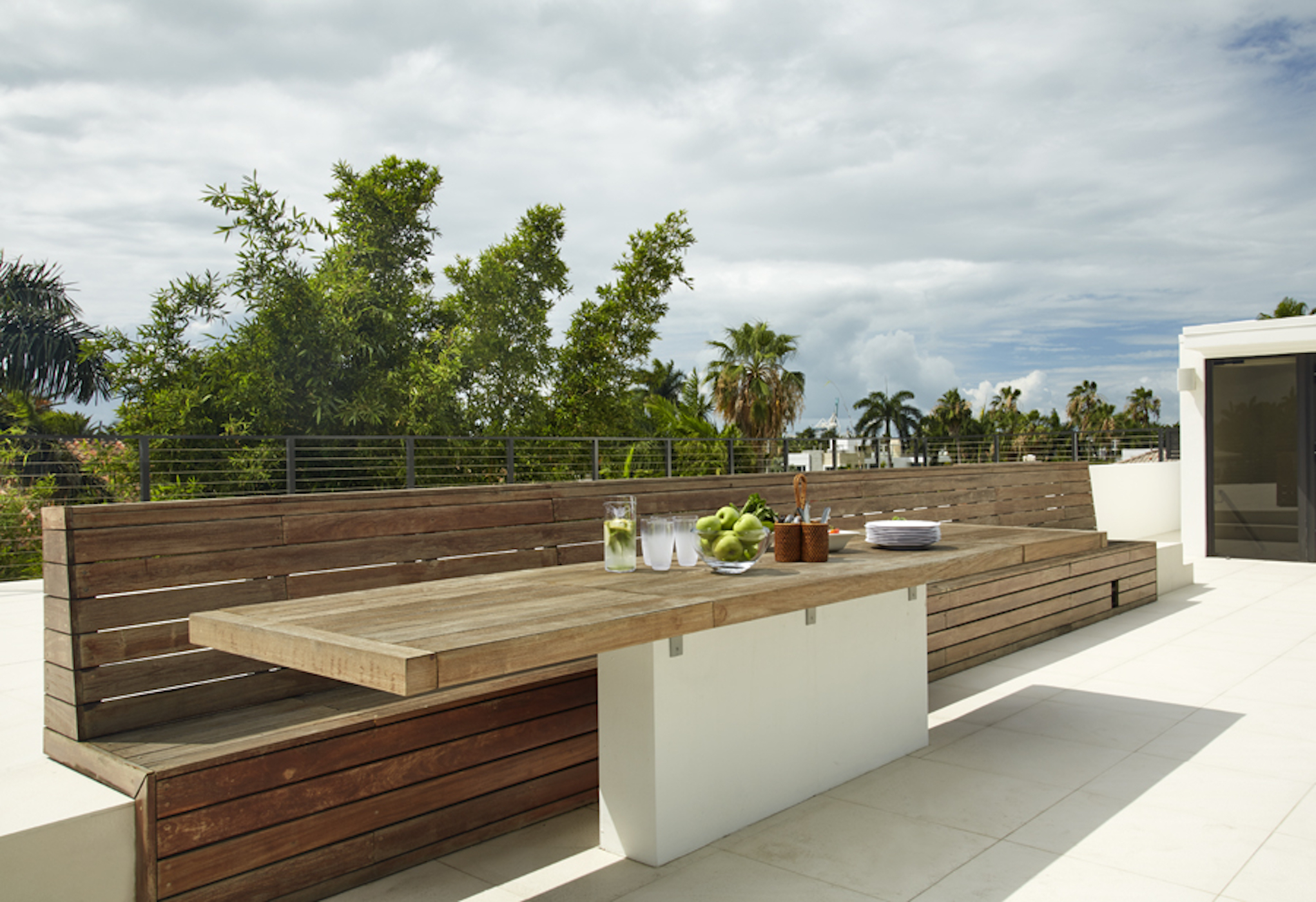 """This rooftop rustic natural wood deck gave the property a """"wow' effect. By Dunagan Diverio Design Group"""